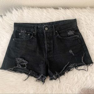 GRLFRND Distressed Black Helena Shorts.